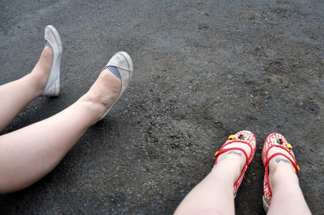 The feet of my travelling companion and I. Waiting for the bus to take us to Graceland.
