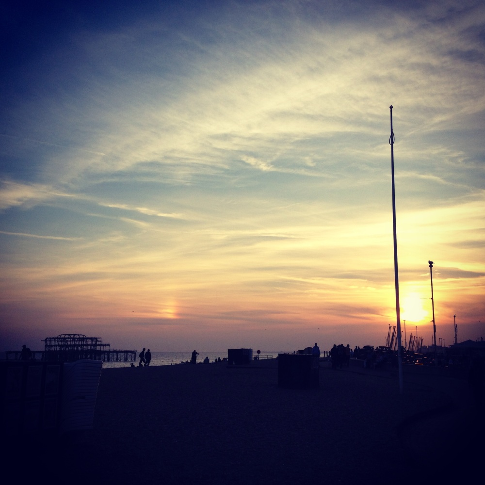 Contrails and a sun dog over Brighton, August 2013