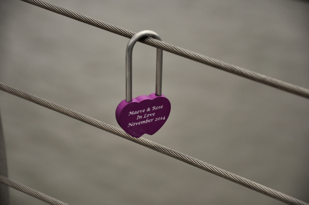 A colourful Lovelock against a grey day on the Millennium Bridge, Nov 2014